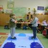 Children using the TOC  conflict diagram as a kinesthetic tool to   think   through a problem in a Polish classroom.
